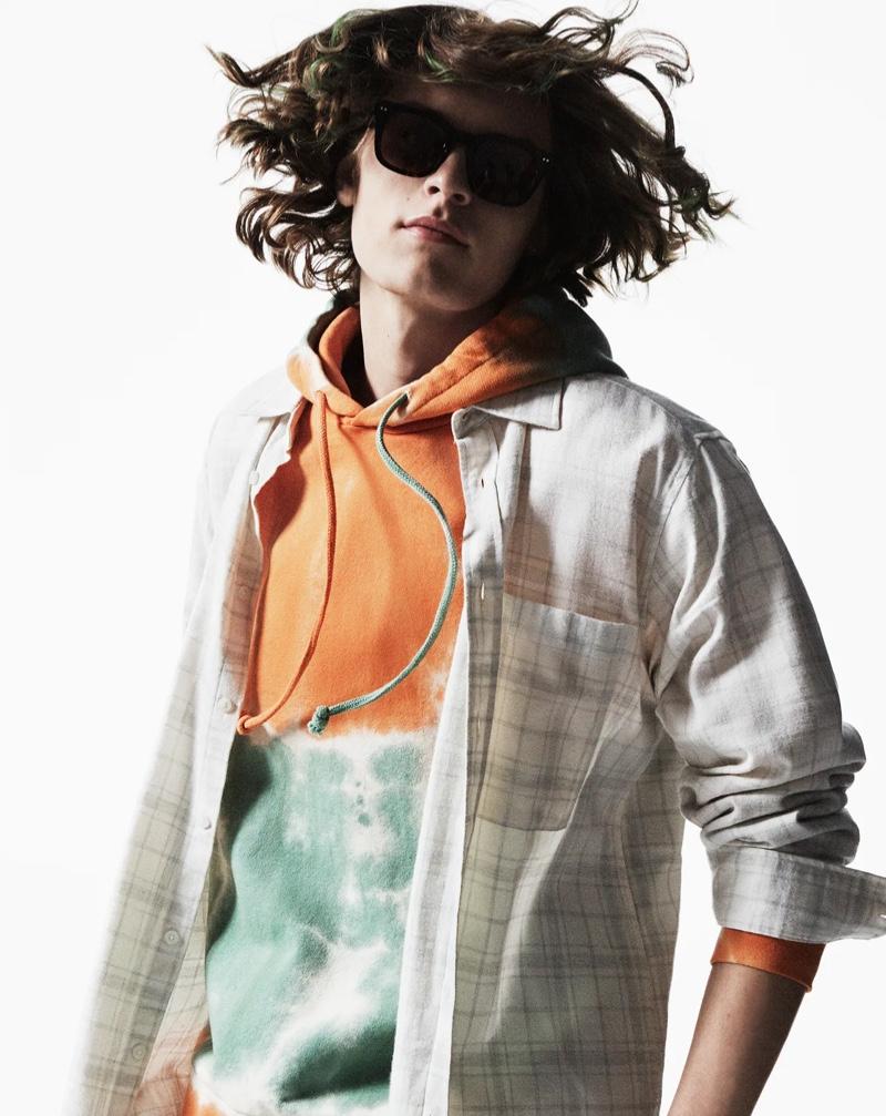 Zachary Norton rocks a tie-dye hoodie and check shirt from Zara.