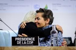 UNFCCC executive secretary Christiana Figueres embraces a colleague after the Paris Agreement is struck.