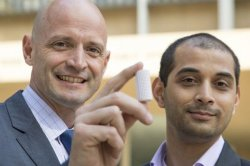 JR DeShazo, left, and Gaurav Sant with a sample of a new building material with which they want to replace concrete.