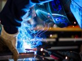 person welding, manufacturing industry