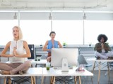The physical health box has been ticked by many workplaces, according to Link Coworking owner and Global Coworking Unconference Conference founder Liz Elam Executives doing yoga in office