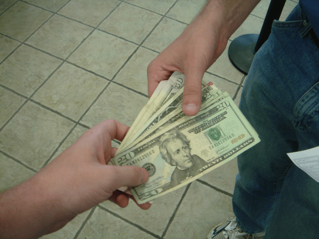 The Pros And Cons Of Borrowing Money - cash image