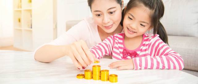 Why Talk About Money With Your Children? - mum and daughter counting coins image