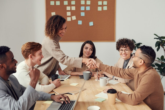 5 UK Organisations That Offer Funding For StartUps And SMEs - successful business meeting image
