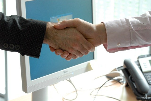 Important Things To Consider When Hiring A Lawyer - handshake image