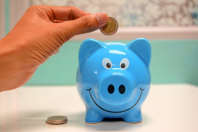 4 Quick Ways To Save That Are Often Overlooked - coin and piggy bank image