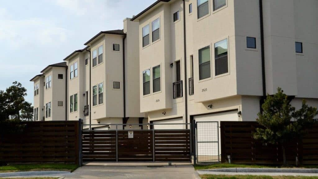 Buying a rental property such as a townhome (displayed) allows the owner to househack!