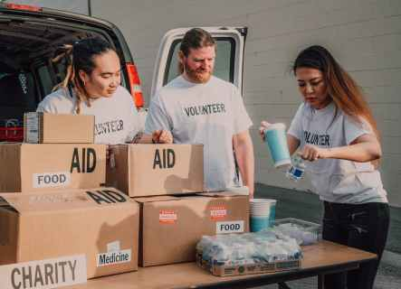 Physical donations being made to a charity with Gift Aid