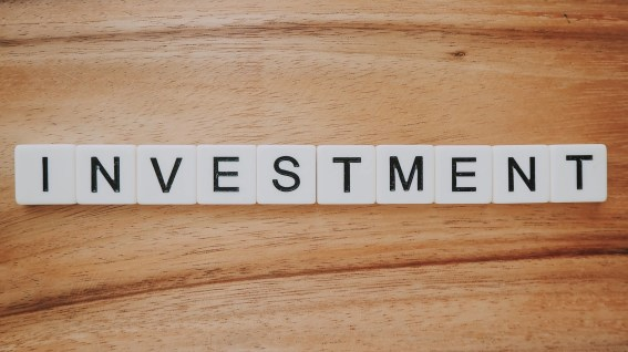 Scrabble tiles spelling out why investment works