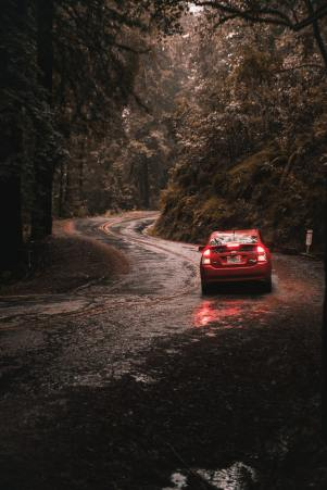 An image of a ZipCar on a UK country road as part of our review