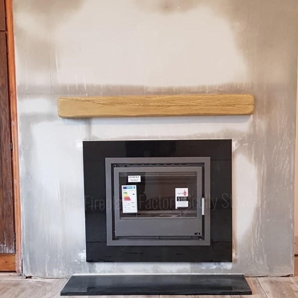 Stylish Boiler Stove, Black Granite Frame, Flat hearth with a light Oak beam