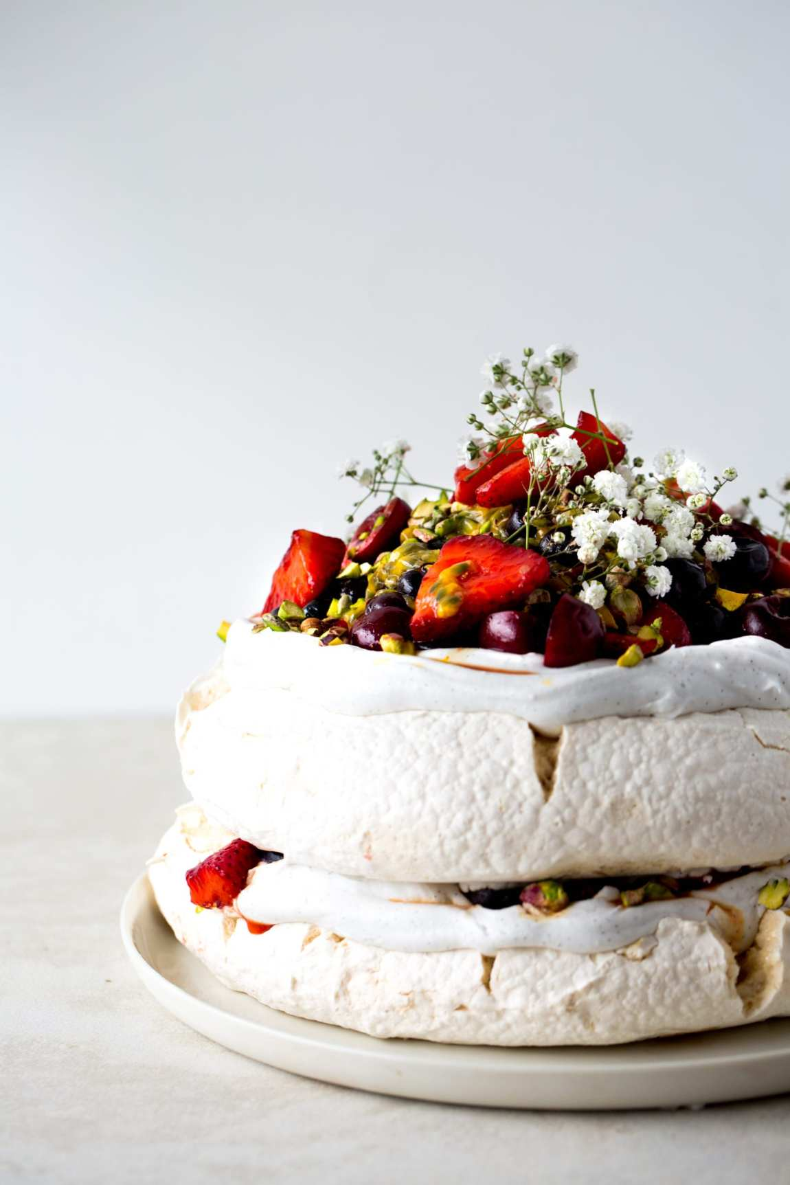 Vegan Pavlova with Saffron Berries Passionfruit + Pistachios | The ...