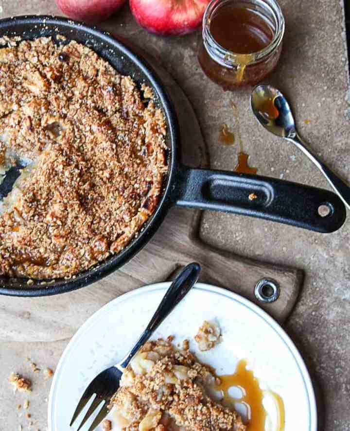 A pan of food on a wooden board, with Apple crisp