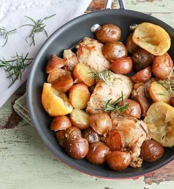 A pan of food, with potatoes and Chicken
