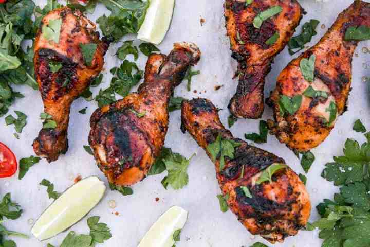 A close up of grilled chicken drumsticks