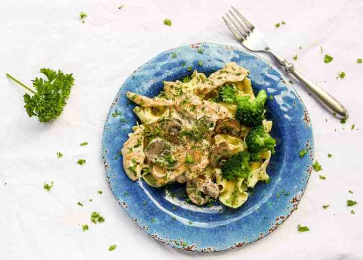 A plate of pasta with broccoli