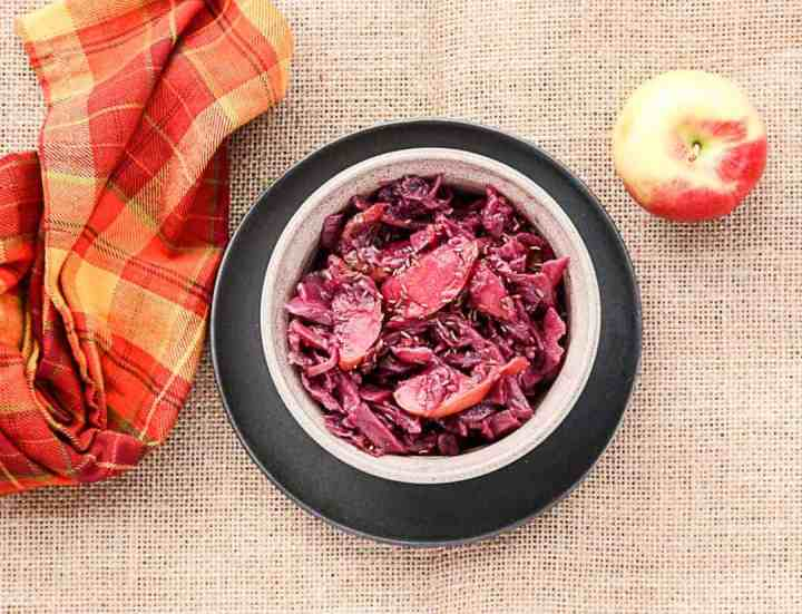 A bowl of food, with Red cabbage