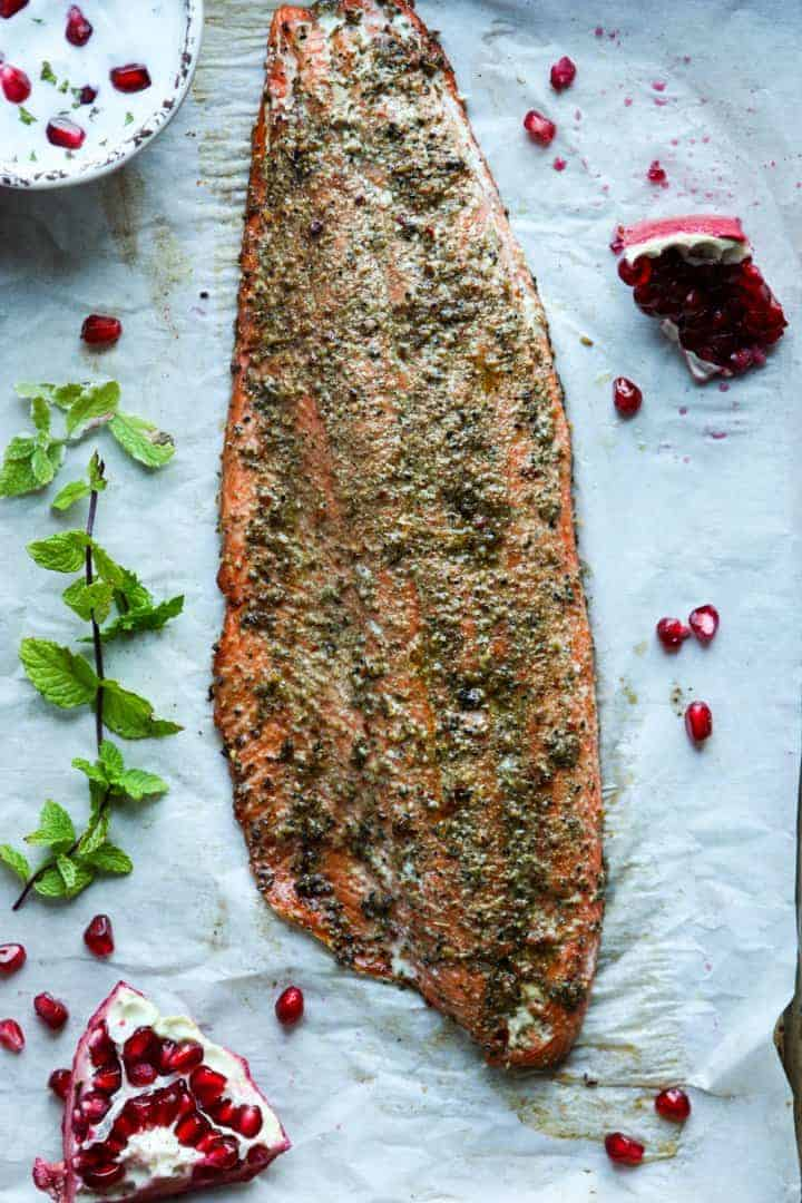 A baked salmon fillet on a tray