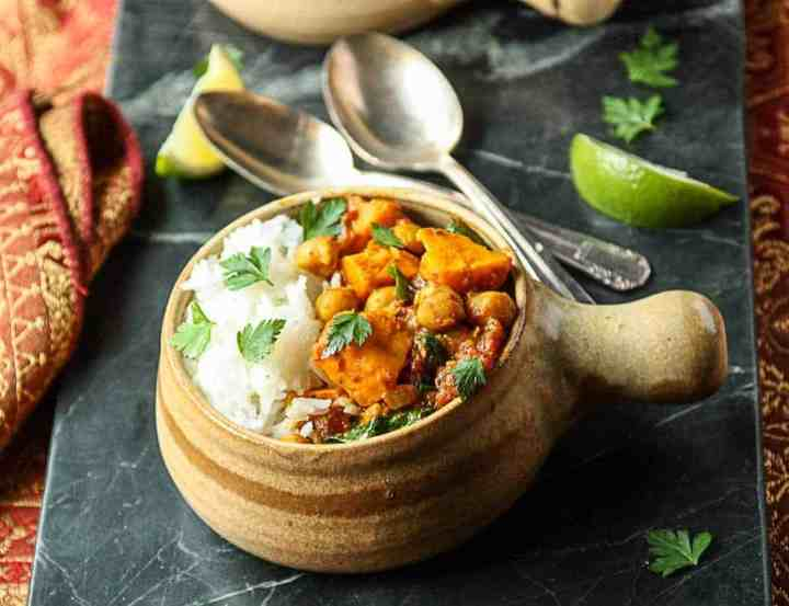 Sweet Potato Chickpea Curry with rice in a pottery bowl