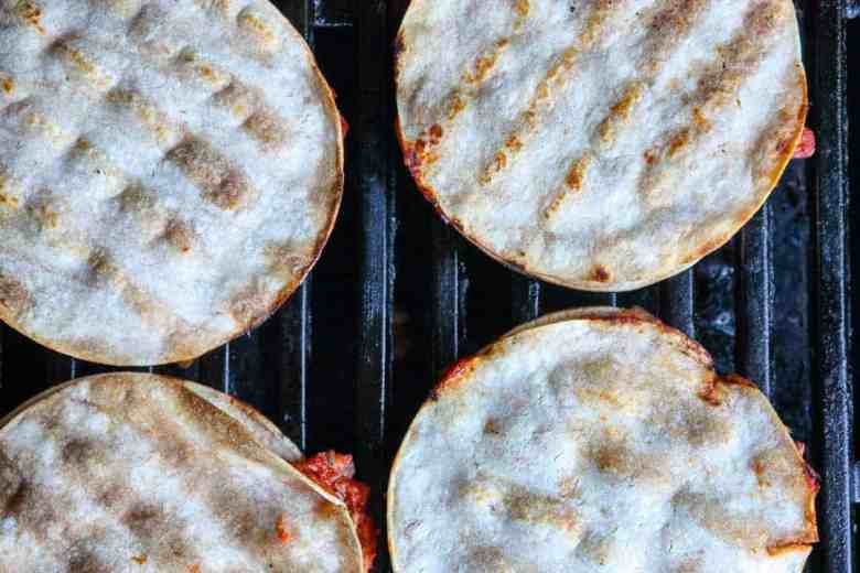 A close up of a tortillas on a grill
