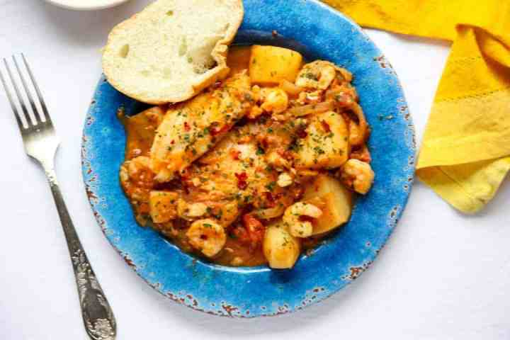 A plate of food, with Fish stew