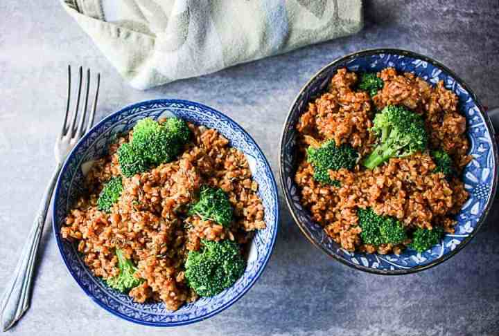 A plate of food with broccoli, and bulgur