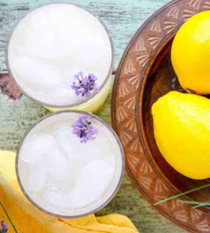 A bowl of lemons on a plate, with Lemonade