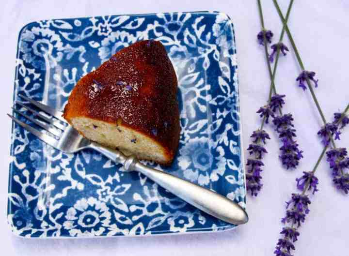 Slice of Lavender Yogurt Cake on a blue & white plate