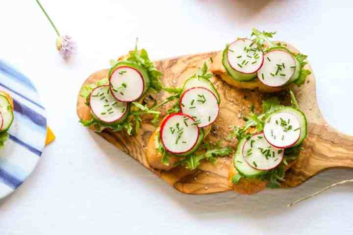 A plate of hors d'oeuvres on a wooden board