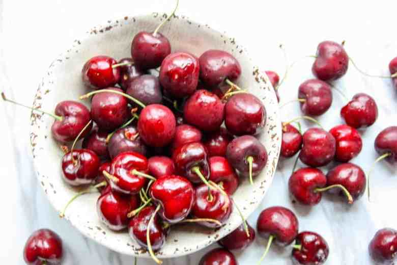 Cherries in a bowl on a table