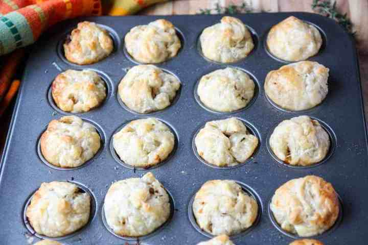 Baked puff pastry appetizers in a mini muffin pan