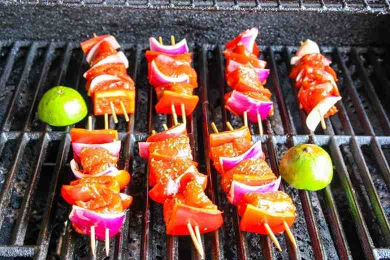 A bunch of food on a grill, with Salmon