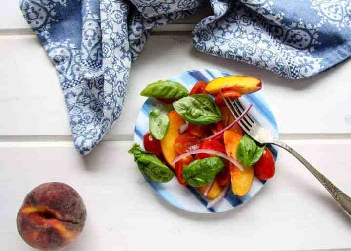 A plate of food on a table, with Peach basil and Tomato