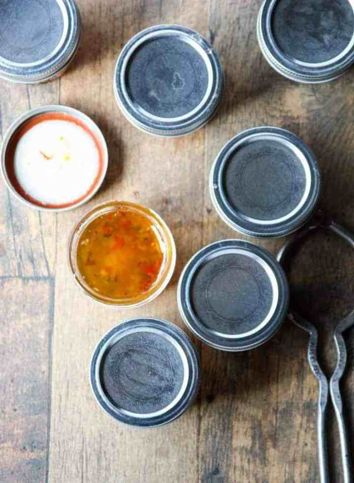 Jars of Pepper Jelly, one with lid off.
