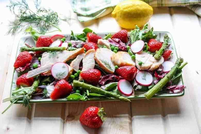 Salad with strawberries, spring vegetables, and chicken