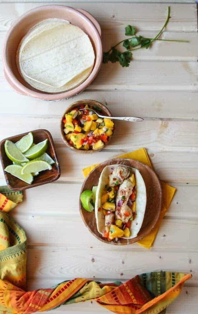 Turkey and Mango Taco with a Dish of Mango Salsa and a Dish of Lime wedges