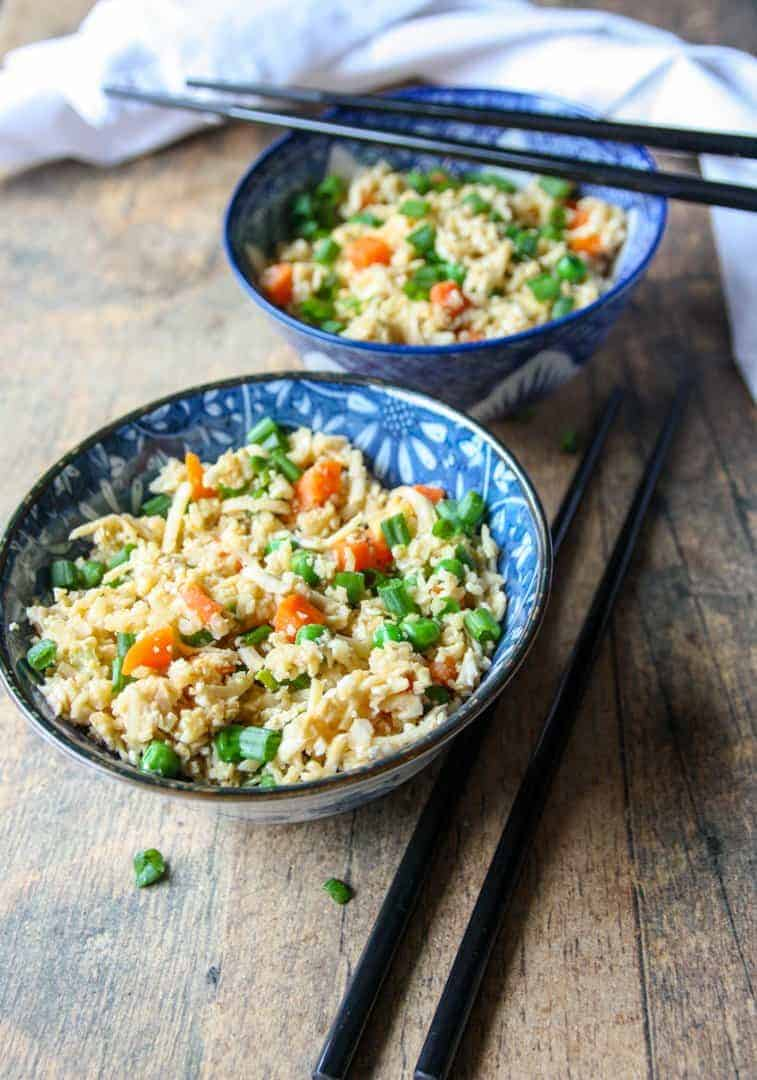 Two bowls of cauliflower rice and vegetables