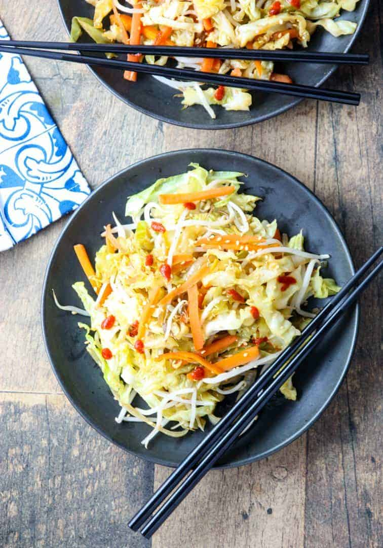 A plate of food on a table, with Chinese cabbage