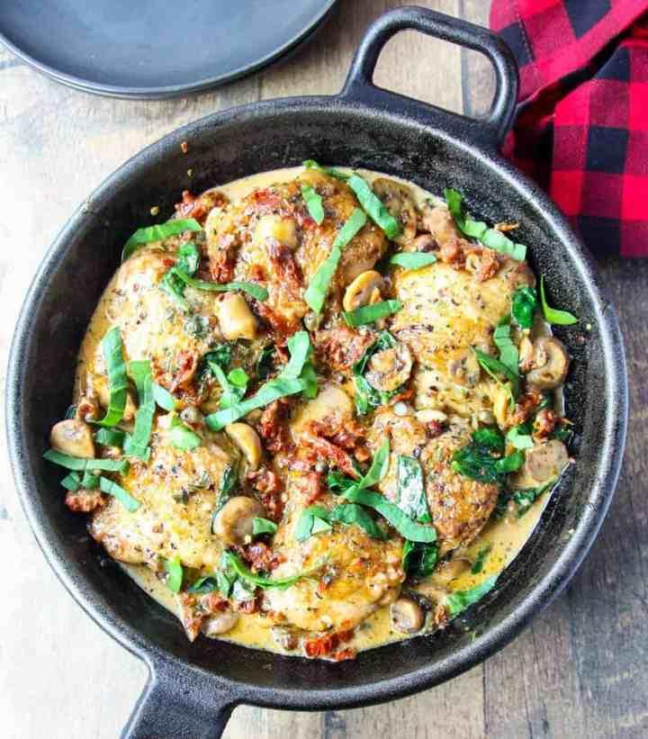 Marry me chicken (Sicilian Chicken) in a black cast iron pan