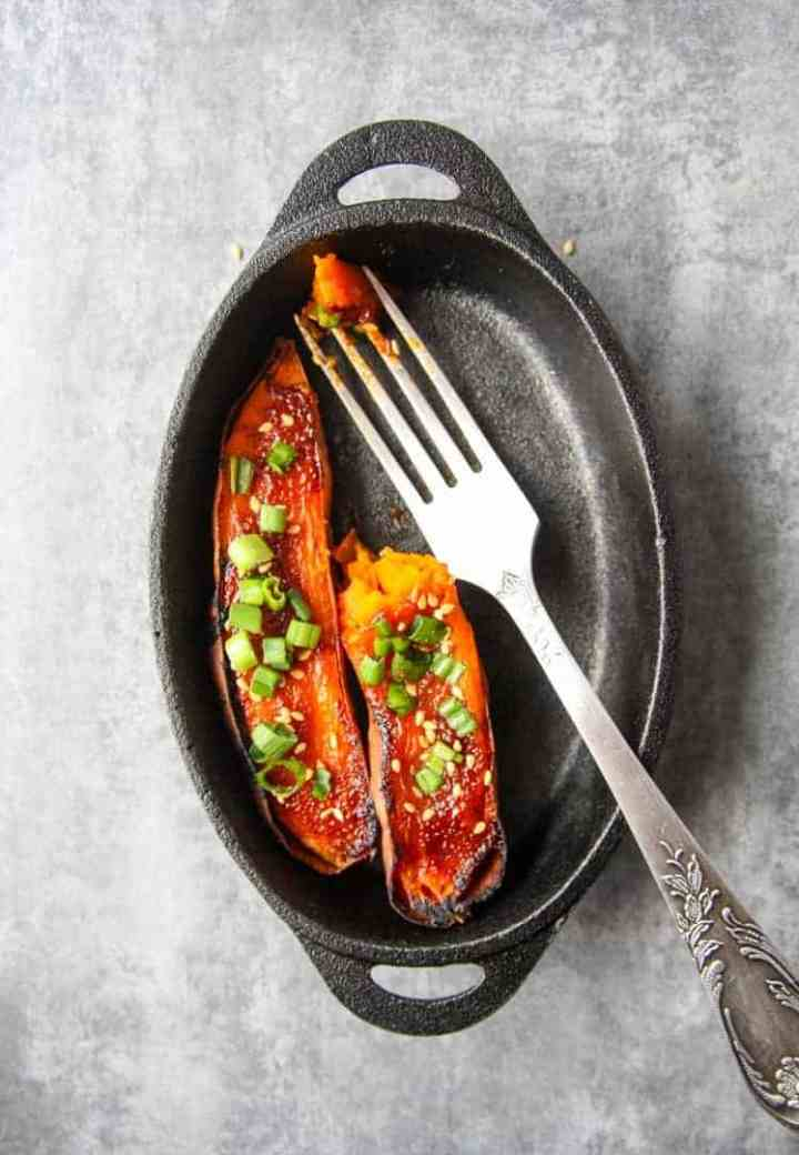 Baked yams in a pan with a fork