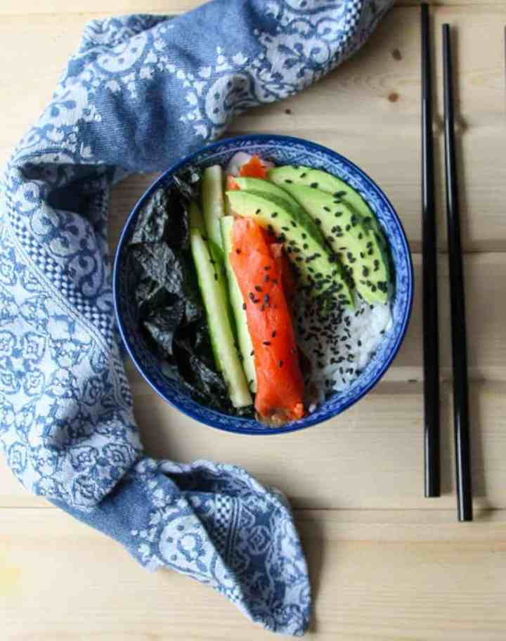 smoked salmon sushi bowl with avocado, cucumber and rice