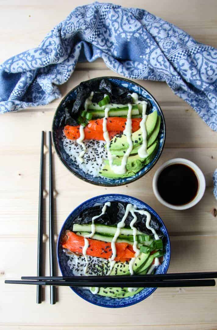 two sushi bowls with two sets of chopsticks