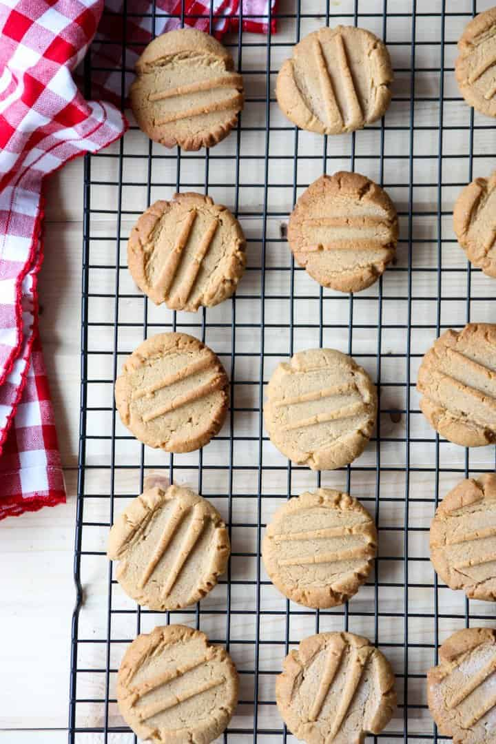 Flourless peanut butter cookies cooling on a wire rack