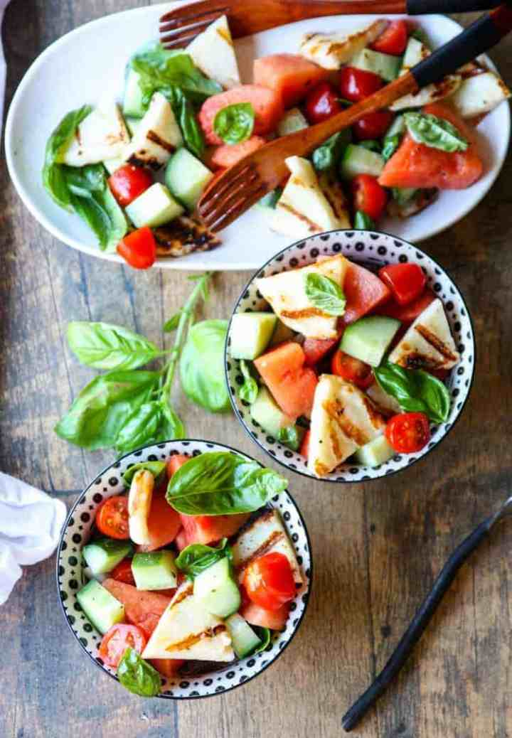 Two black & white bowls of Grilled Halloumi & Watermelon Salad