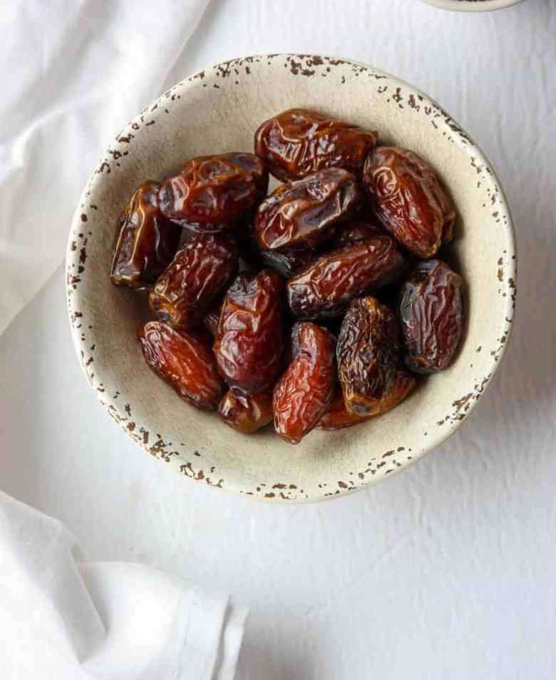 A bowl of dates on a table