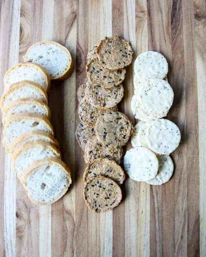 Bread and Crackers on a wooden cutting board