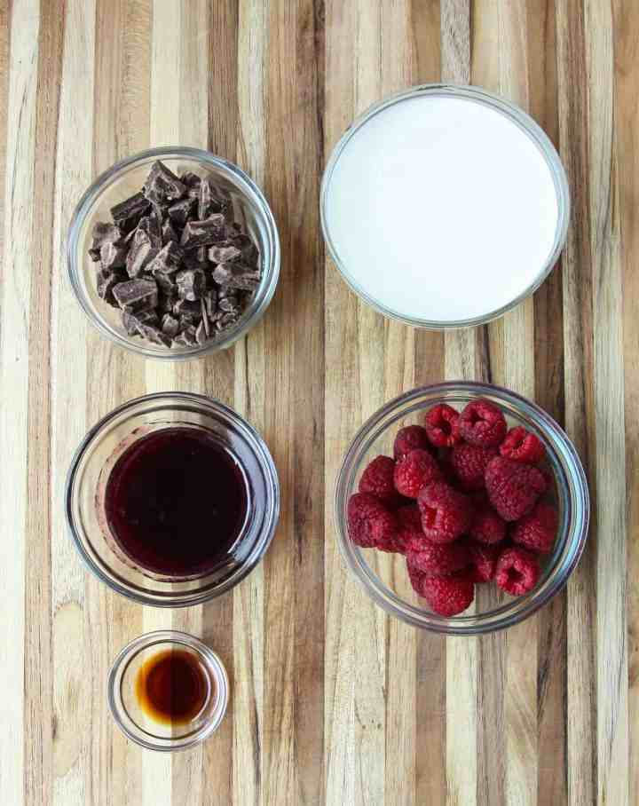 The ingredients to make this recipe in glass bowls on a wooden board.
