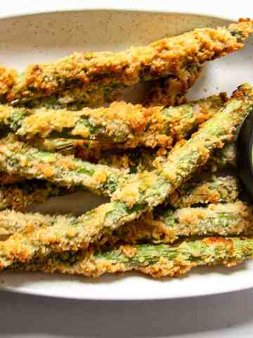 A close up of fried asparagus on a plate.