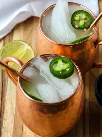 Two Mexican Mule Cocktails in copper mugs.