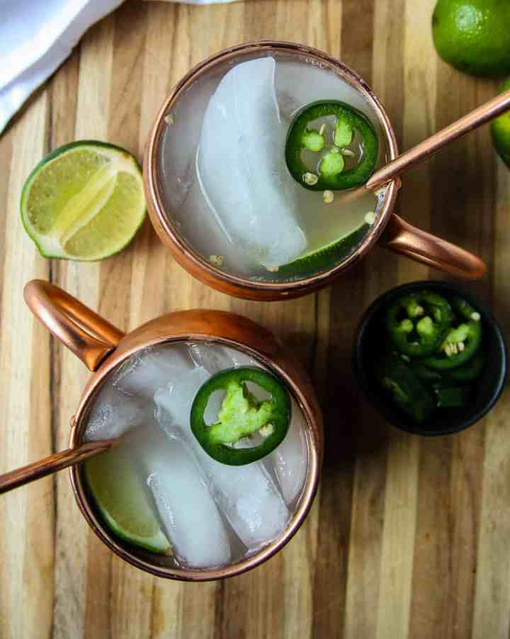 Two Mexican Mule beverages in copper mugs.